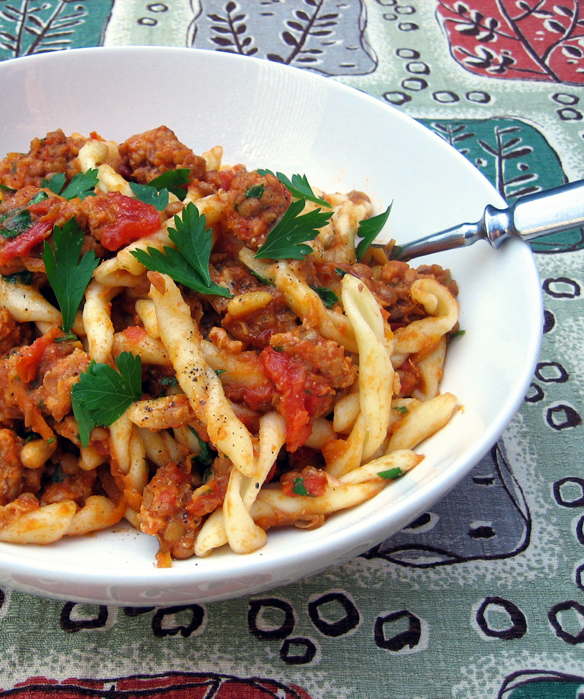 Fusilli with pork sausage and lentils