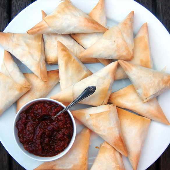Baked filo pastry samosas. One Equals Two.