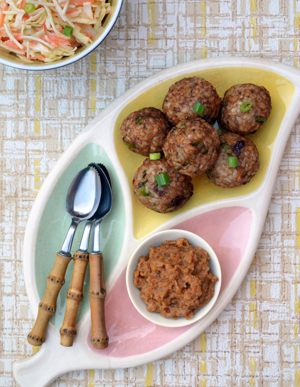 Brown rice balls with chunky peanut sauce