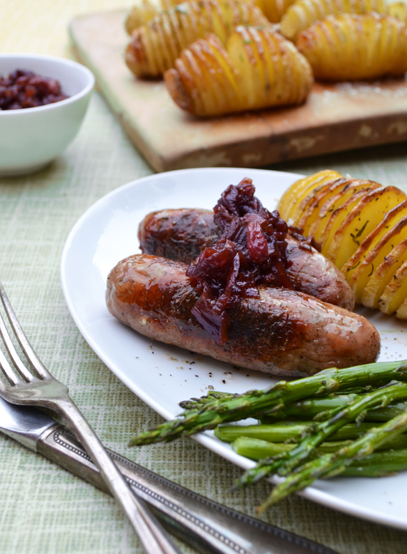 Bangers with caramelised onions and hasselback potatoes