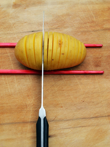 Chopstick guide for hasselback potatoes