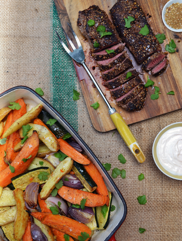 Dukkah lamb with tray-roasted veggies. One Equals Two.
